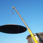 Image of a crane installing the Dome Roof Tank