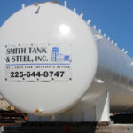 Image of a white tank that has the Smith Tank  Steel logo on the side of it.