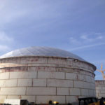 Image of a 206 foot diameter by 60 foot height IFR with GEO Domes erection from the side on the outside