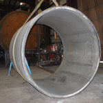 Image of a 8 foot 6 inch diameter by 31 foot 10 inch long 316SS 3.5 inch thick tank showing a inner piece of the tank.