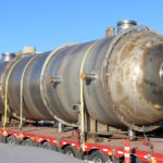 Image of a 8 foot 6 inch diameter by 31 foot 10 inch long 316SS 3.5 inch thick tank on a trailer